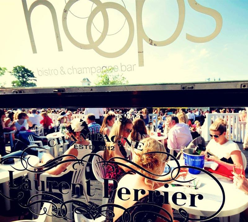 Crowds sitting in the outside seating area of the Hoops Bistro at Uttoxeter Racecourse.